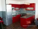 Červená paneláková kuchyně