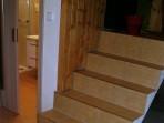 Fotogalerie interiérů - obložení schodu dlažbou s lištou Z